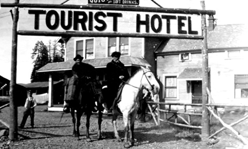 Men on horses near the Tourist Hotel in Forks.